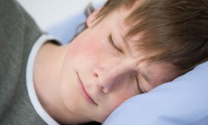 A teenage boy sleeping